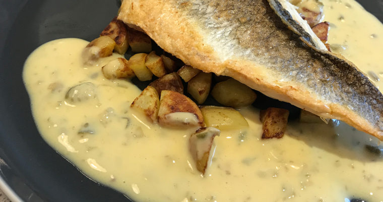 Seabass with a creamy caper sauce