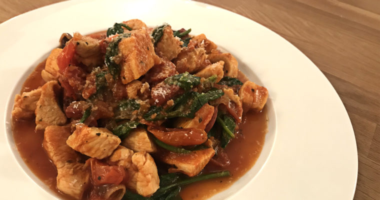 Chicken with tomato, chorizo and spinach
